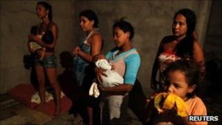 """Women and children from Brazil's """"Roofless Movement"""" in an empty building they have occupied in Sao Paulo"""