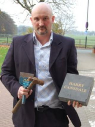 Graeme Cansdale holding brick, chisel and hammer