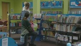 People chatting inside a library