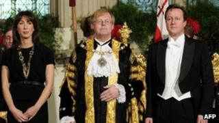 David Cameron (R) at the Lord Mayor's banquet in London, with his wife Samantha (L) and Lord Mayor of London David Wootton (C)
