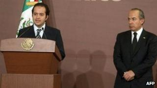 Mexican President Felipe Calderon (R) listens as new Mexican Interior Secretary Alejandro Poire (L) speaks at the Los Pinos Residence in Mexico City on November 17, 2011.