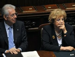 Italian Prime minister Mario Monti (L) takes his place beside Interior Minister Anna Maria Cancellieri in the Italian lower house, 18 November