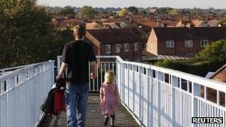 A man and his daughter on a council estate in Derby