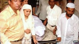 This file photo taken on 18 June 2004 shows Shamima Kausar (second from left) collecting the body of her daughter Ishrat Jahan from a hospital in Ahmedabad