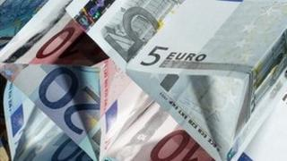 euro notes floating in the air