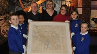 David Ellesmere, Jayne Austin, Bryony Rudkin and children from Murrayfield Primary School with the map of bombing targets in Ipswich