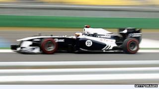 Williams driver Rubens Barrichello in his Randstad branded car