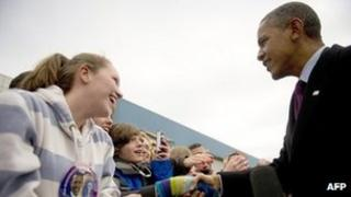 US President Barack Obama (R) at airport in Manchester, New Hampshire, on 22 November 2011