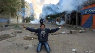 Protester in Egypt kneels on ground