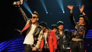 Korean boy band Big Bang accepts their Worldwide Act award onstage during the MTV Europe Music Awards 2011