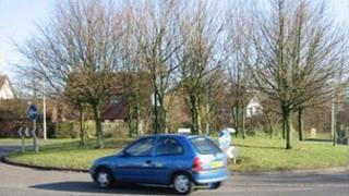 Car at roundabout