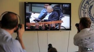 Journalists photograph former Khmer Rouge deputy prime minister and minister of foreign affairs Ieng Sary on Wednesday