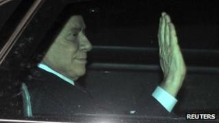 Silvio Berlusconi leaves the Justice Palace in Milan, 22 November