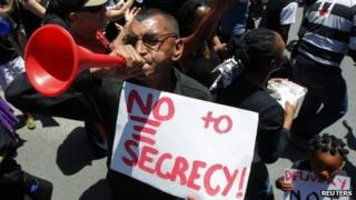A demonstrator protests against the passing of the Protection of Information Bill outside parliament in Cape Town, 22 November 2011