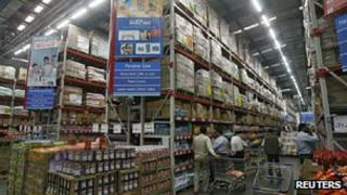 Customers shop at a Best Price Modern Wholesale store, a joint venture of Wal-Mart Stores Inc and Bharti Enterprises in Punjab