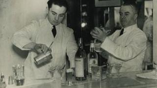 Harry MacElhone (left) behind the bar at Harry's in earlier years