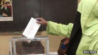 A woman votes at a school in Marrakech 25 November 2011