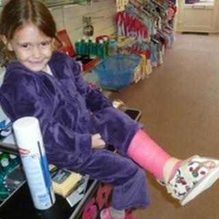 Sienna Barnett with cast on her leg