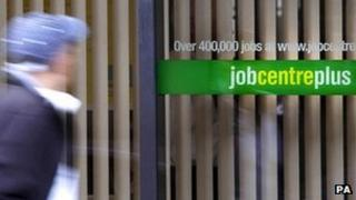 A young man passing by a Jobcentre Plus
