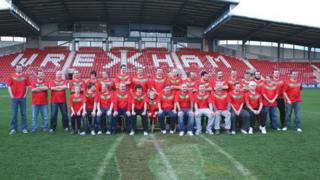 """The new North Wales Crusaders """"squad"""" lining up on the Racecourse pitch"""