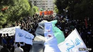 Demonstrators march against President Bashar al-Assad in Deir Balaba near Homs on 27 November 2011