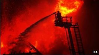 firefighter tackles blaze