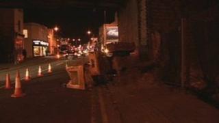 Mini digger crash into railway bridge in Cheltenham