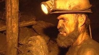 File photo of Afghan coal miner (June 2010)