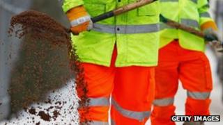 Council workers spread grit