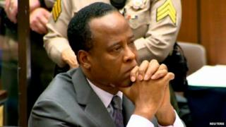 Michael Jackson's former doctor, Conrad Murray, listens as a judge sentences him to four years in prison