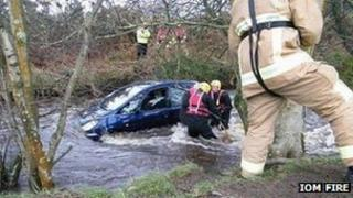 A man is rescued from a car in the River Neb