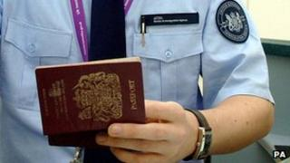 Immigration official checking British passport