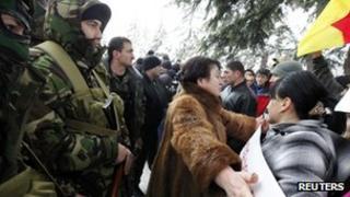 Alla Dzhioyeva (C) outside the central Election Commission building in Tskhinvali (30 Nov 2011)