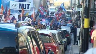 Protesters marching through Birmingham to a pensions rally