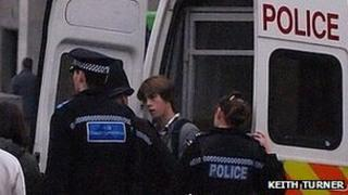 Lewis Stainer being spoken to by police