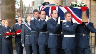 Members of the RAF carry the coffin into Coventry Cathedral