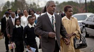 Robert Champion's parents lead a procession for their son's funeral on 30 November 2011 in Decatur, Georgia