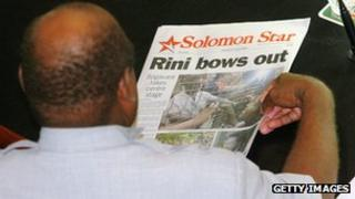Man reads Solomon Star newspaper