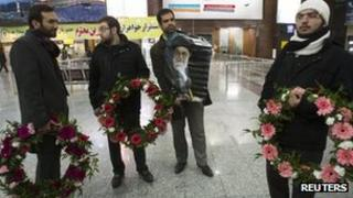 Supporters of the expelled Iranian diplomats at Tehran airport - 3 December 2011