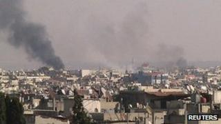 Smoke rises from the city of Homs (4 December 2011)