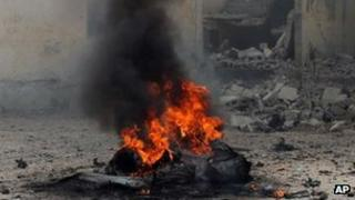 A car burns shortly after it exploded in Mogadishu