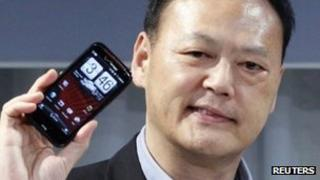 HTC chief executive with smartphone