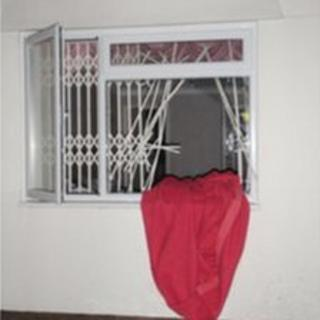 The cut window grille where the woman was trapped