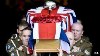 Pallbearers carry Lt David Boyce's coffin