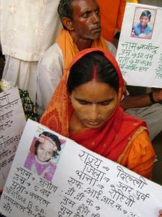 File photo of parents of missing children at a rally in Delhi