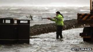 Worker clearing drains in Helensburgh