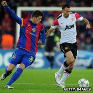 Granit Xhaka of Basel and Ryan Giggs of Manchester United in Champions League action