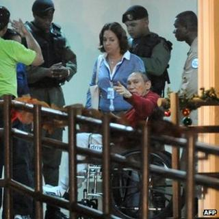 Former Panamanian dictator Manuel Noriega (red) after arrive at the Renacer prison, 25 km south east of Panama City, on December 11, 2011