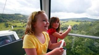 Passengers in a cable car at The Heights of Abraham in the Peak District