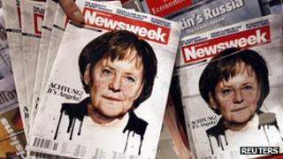 Copies of Newsweek magazine at a train station in Berlin, Germany, on 13 December 2011